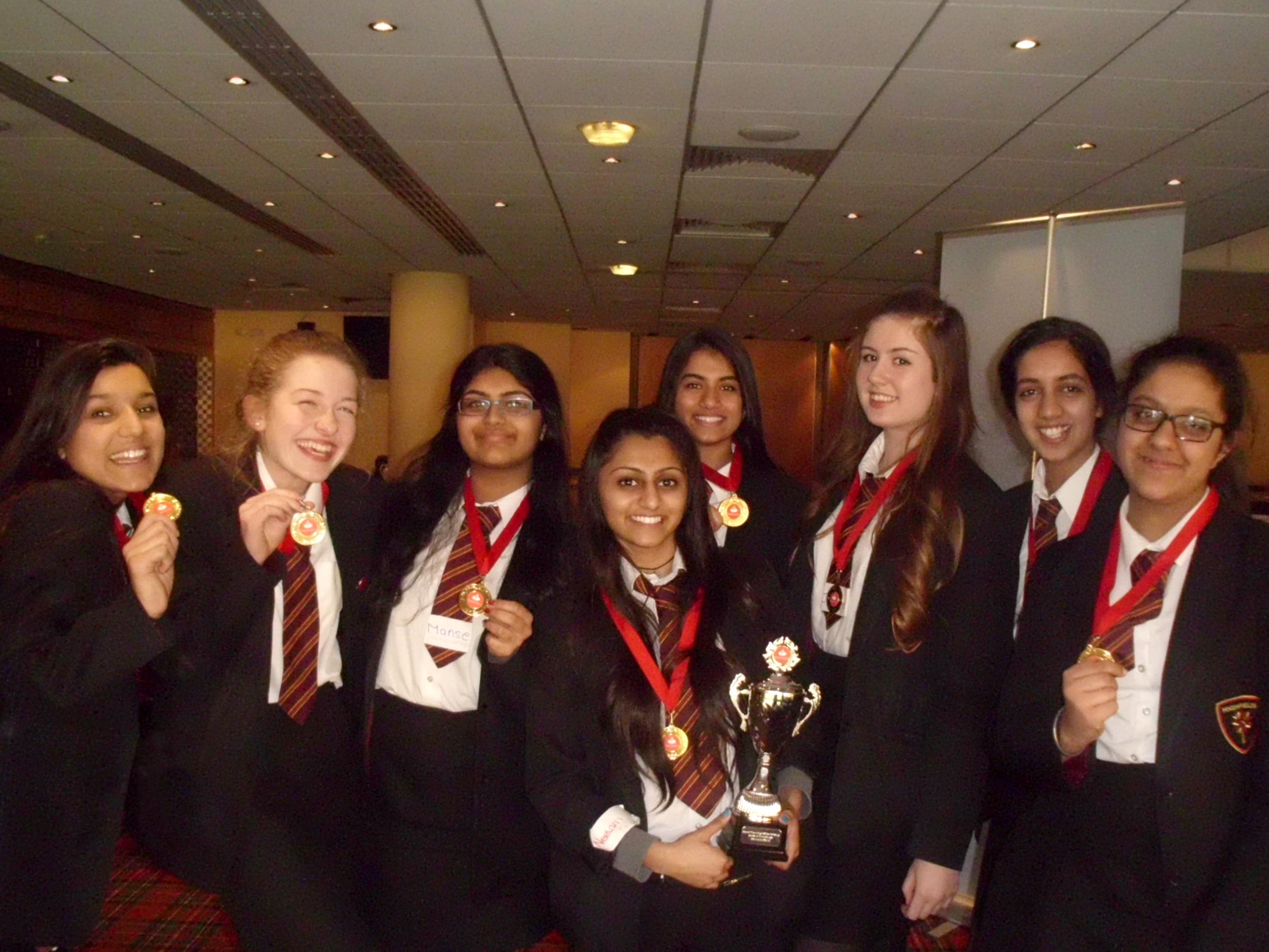 Students:Neelam Patel,Manse Jassi,Ellie White,Amnique Sidhu,Mishal Ishaq,Jordanne Farley-Moss,Jindveer Khangura,Harsimran Shuthar with their trophyand competition medals.