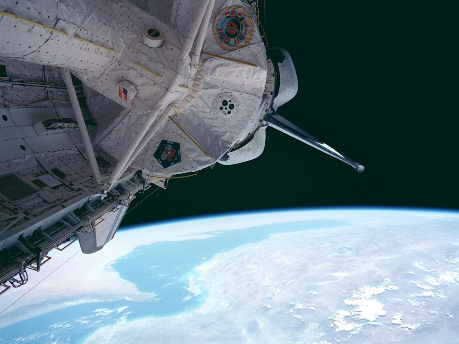 Columbia with Spacelab module in payload bay over the Straights of Hormuz.