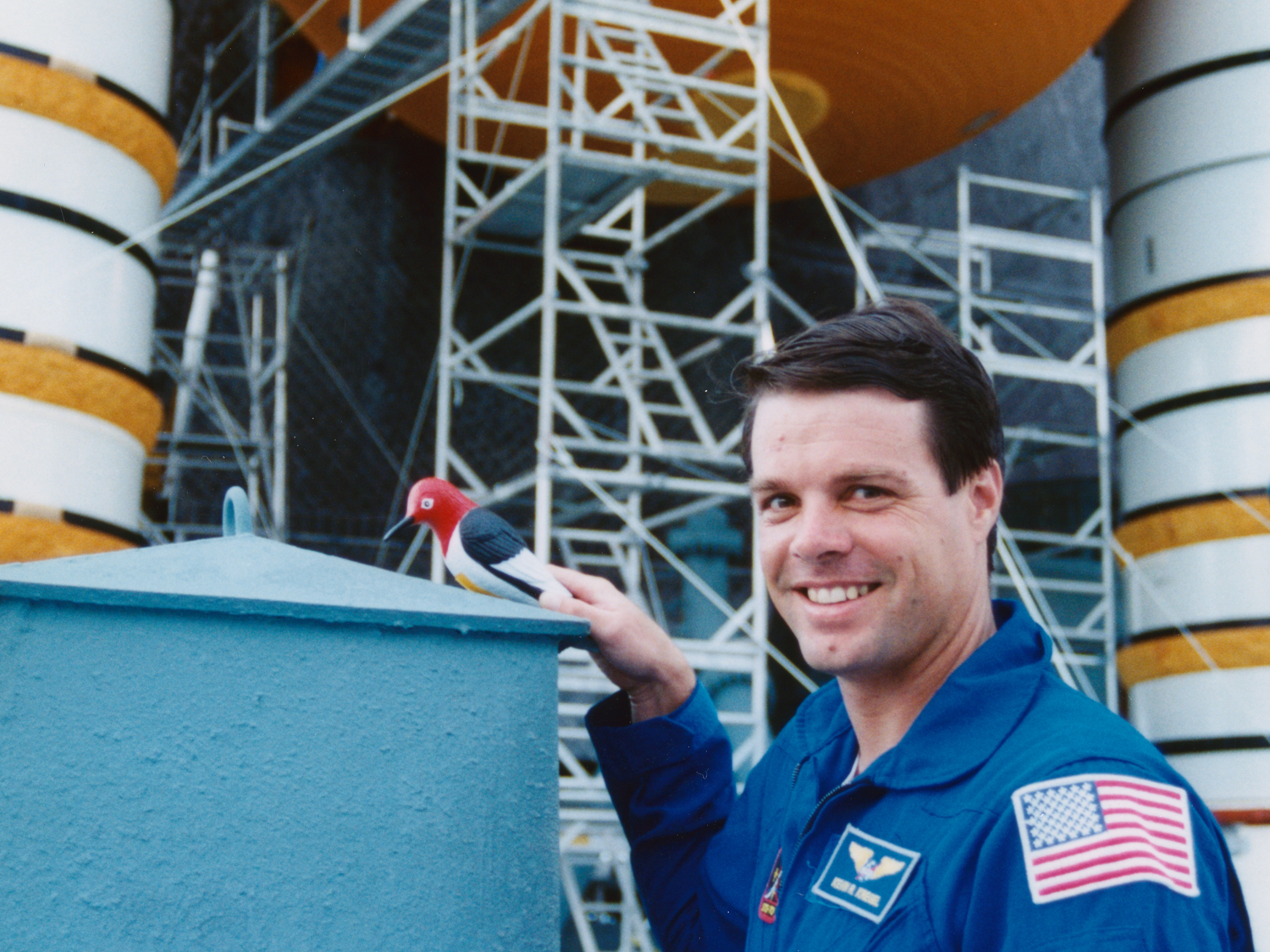 Pilot Kevin Kregel poses while repairs are made (photo Don Thomas).