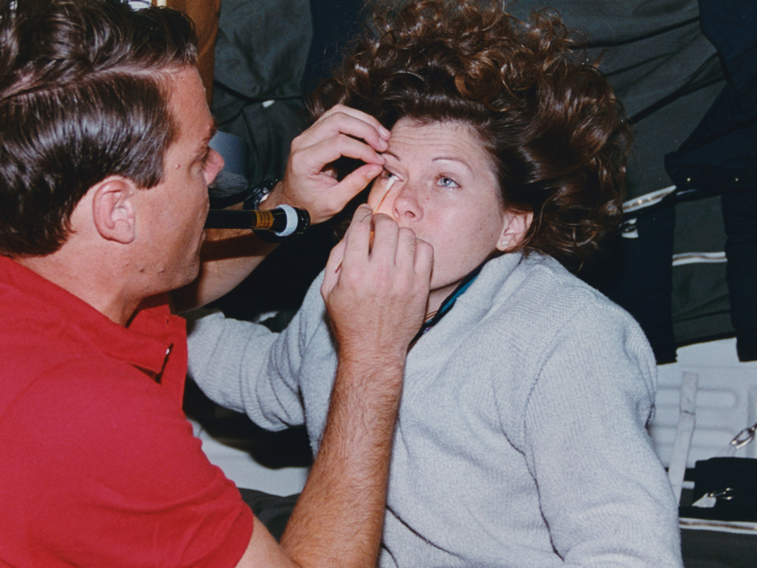 Dr. Kregel removes dust particle in eye.