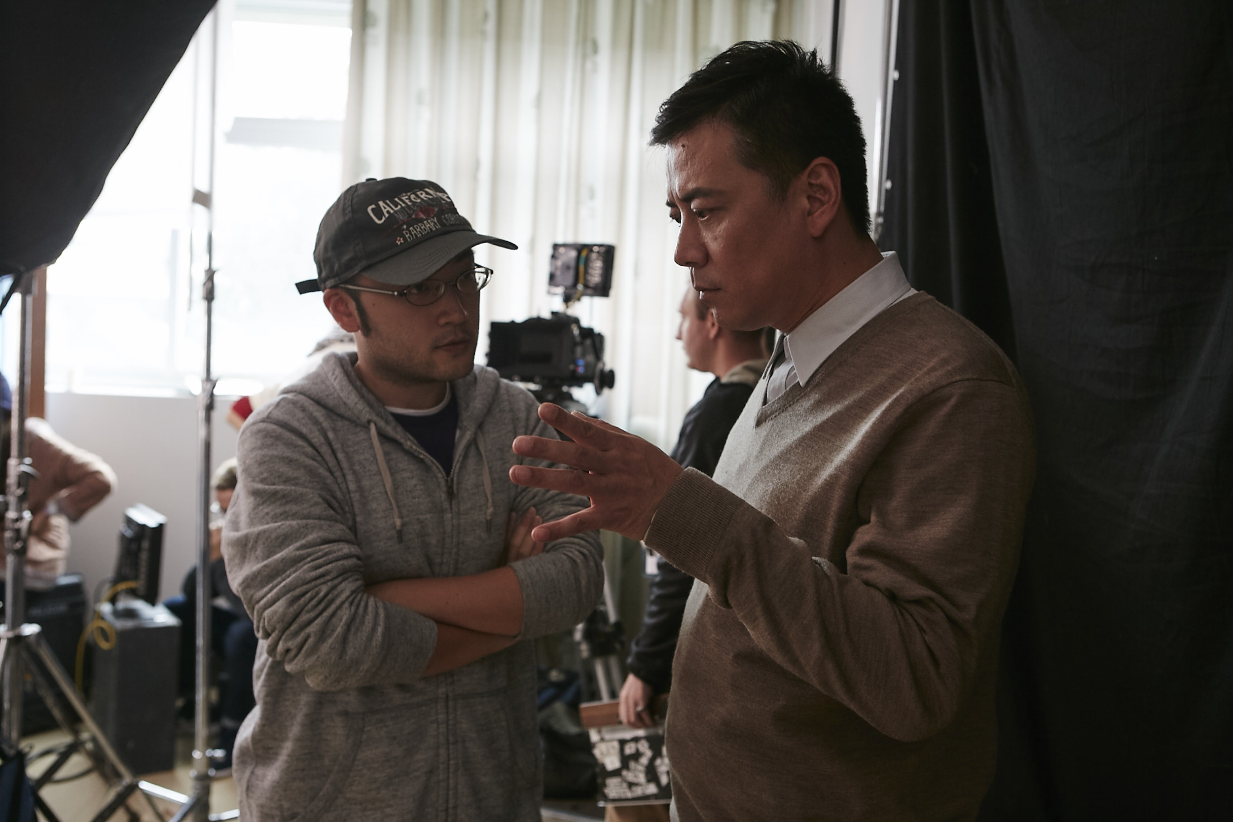 Director Jianjie Lin (Left) discussing a scene with actor Shengsheng Zhao