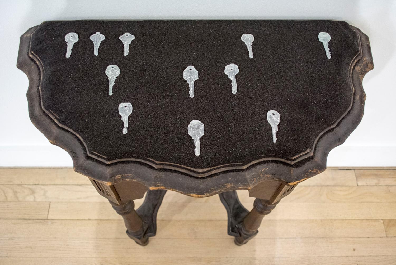 "Keys to the City  (detail), 2016 10' x 5' x 1'7"" Wood, glass keys, sand, ratchet straps."