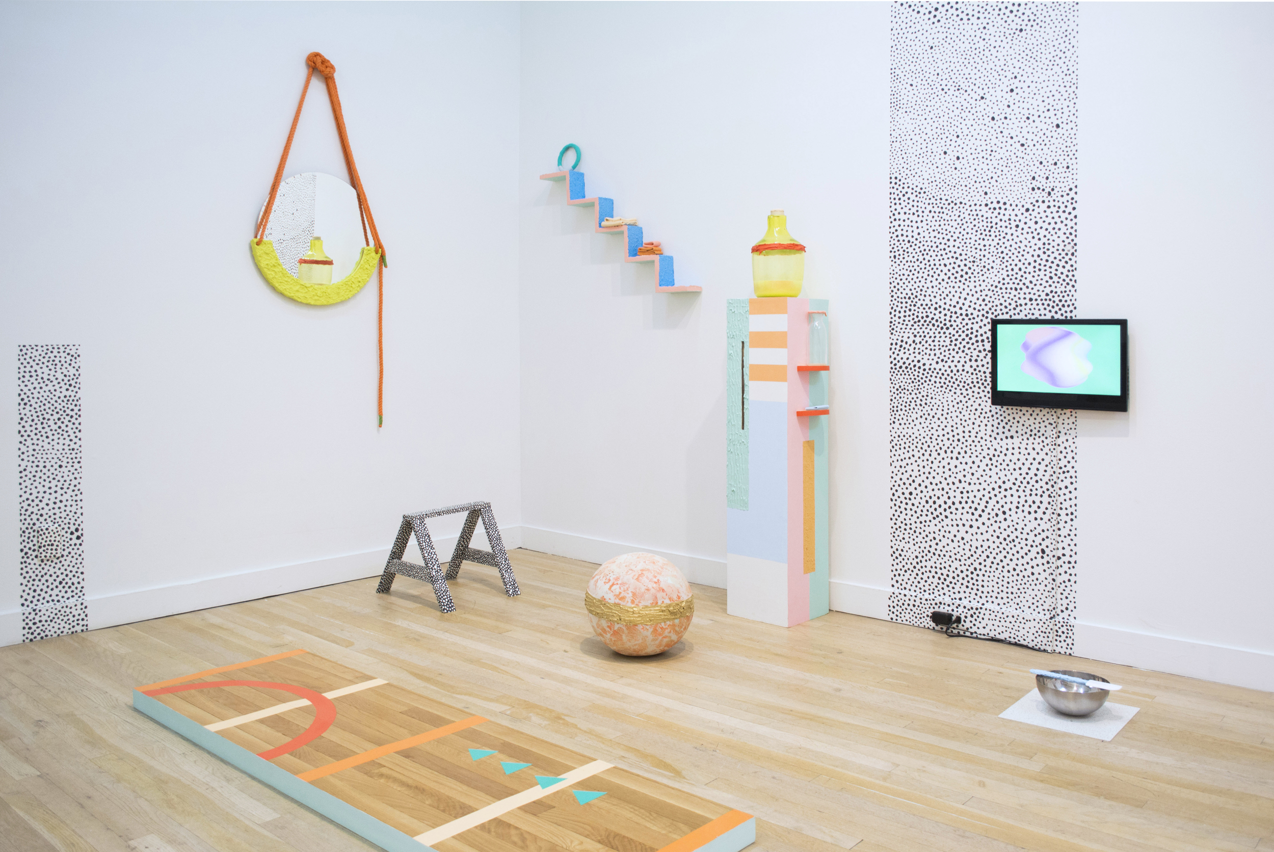 Rachel Debuque   Glisten , 2016  Site-specific performance installation including glass, bondo, clay, slime, rubber, sand, wood, paint, female bodybuilder, video animation,  Kickball , by Plakookee.Approximately 8' x 10' x 8'  Commissioned by CUE Art Foundation.