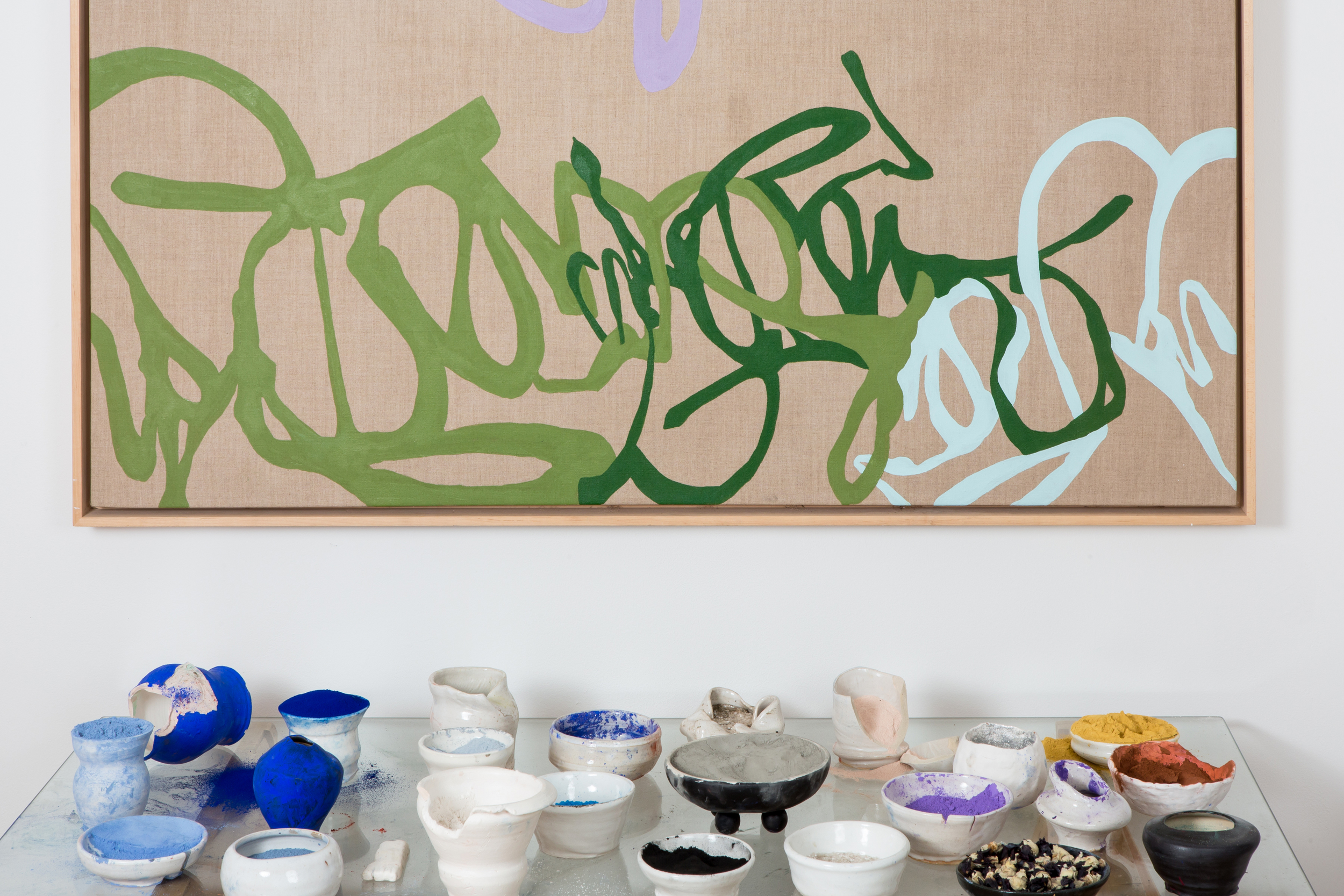 """Carolyn Carr  Detail from  Table from the Painter's Studio , 1996-2016  comprising:   The Painter's Table , 1996-2016  Lizella Clay stoneware vessels, artist glazes, natural and mineral pigments, wood, plaster, glass  58"""" x 28"""" x 28""""    (ON WALL)  Uncharted Path , 2007  Pigments and latex on linen, 48"""" x 60""""  Photo by Marcie Revens."""