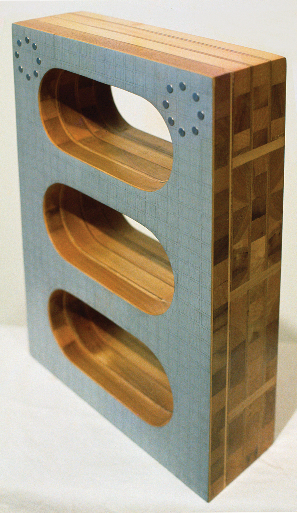 """Figure 3. Marilyn Lerner,  What Goes Around Comes Around , 1969. Laminated wood, acrylic paint, graphite pencil, and metal studs, 18"""" x 13"""" x 5"""""""