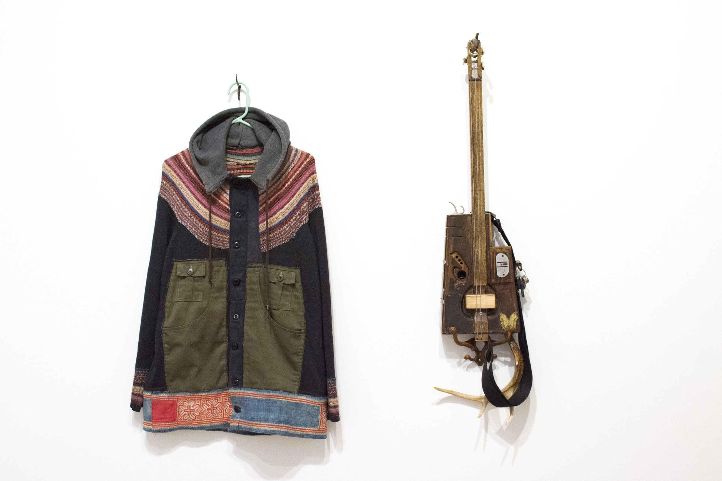 """Left:Jacket, 2017. 32""""H x 24""""W. Found Fabric.  Right:Thunder Zither, 1995-2017. 30.5""""H x 10""""W x 2""""D. Mixed Media"""
