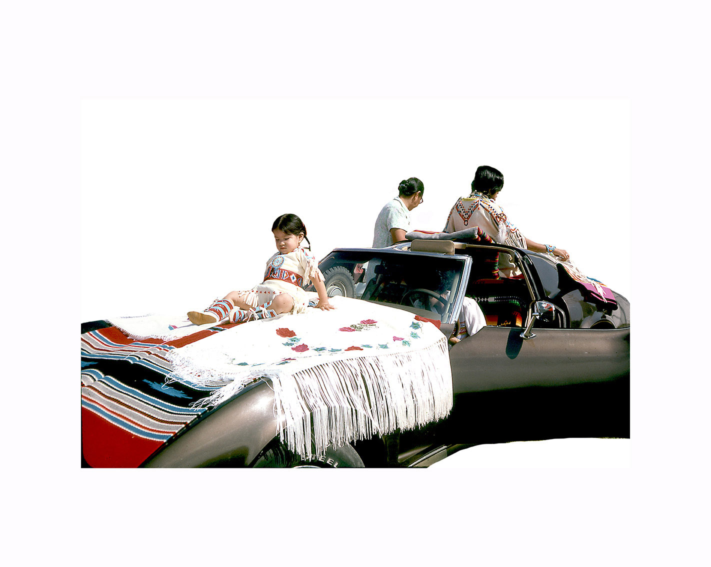 Wendy Red Star,  Grandmother & Parade Corvette , 2014, slide of Crow Fair parade at Crow Agency in the 1970s, archival pigment print.