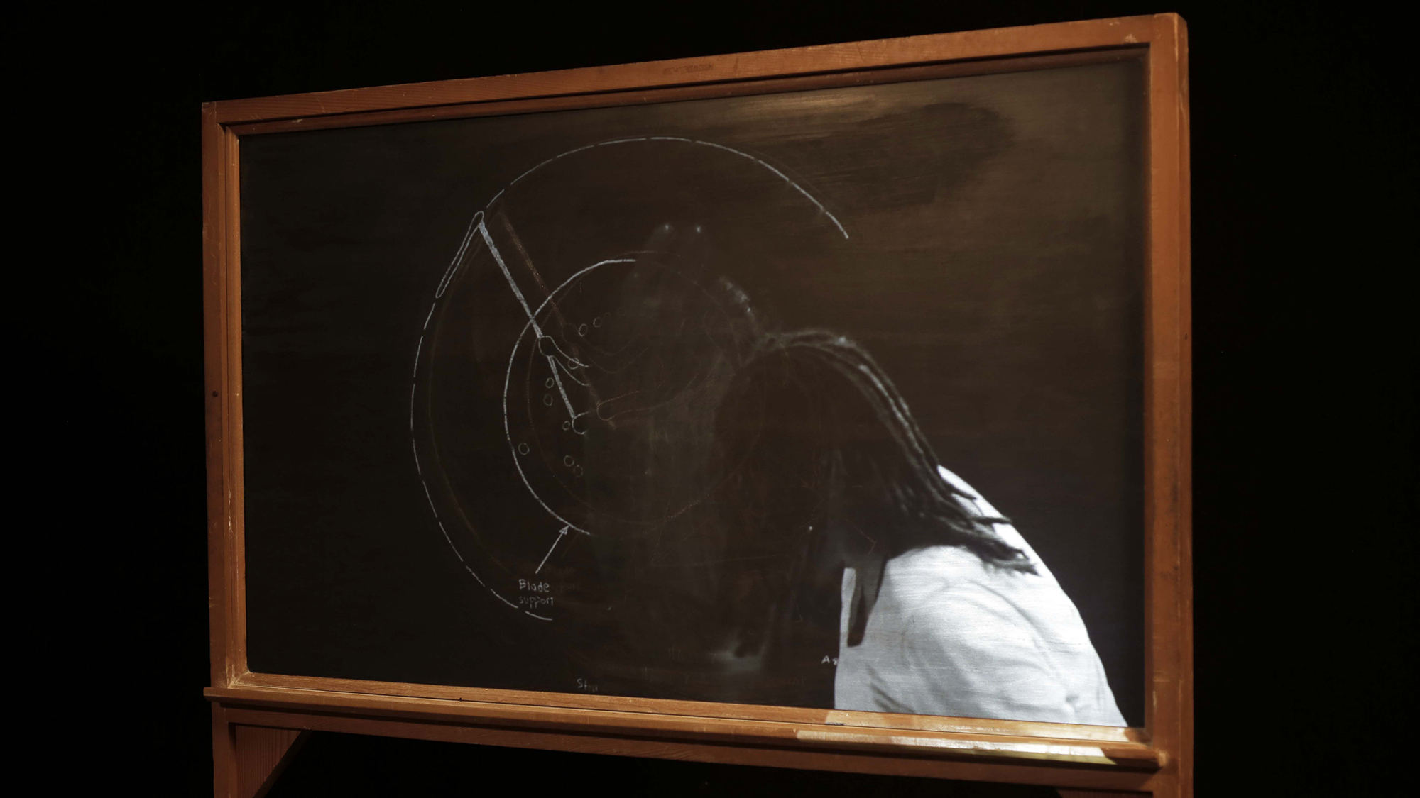 Ariel Jackson  Ghost Image: (Re)Creation and (Re)Understanding  2017  Two-sided chalkboard, chalk, projection, video, image sourced from Judith Carney's  Black Rice: The African Origins of Rice Civilization in the Americas , artist's grandfather's 1970s farm machinery handbook 60 x 72 x 2 inches