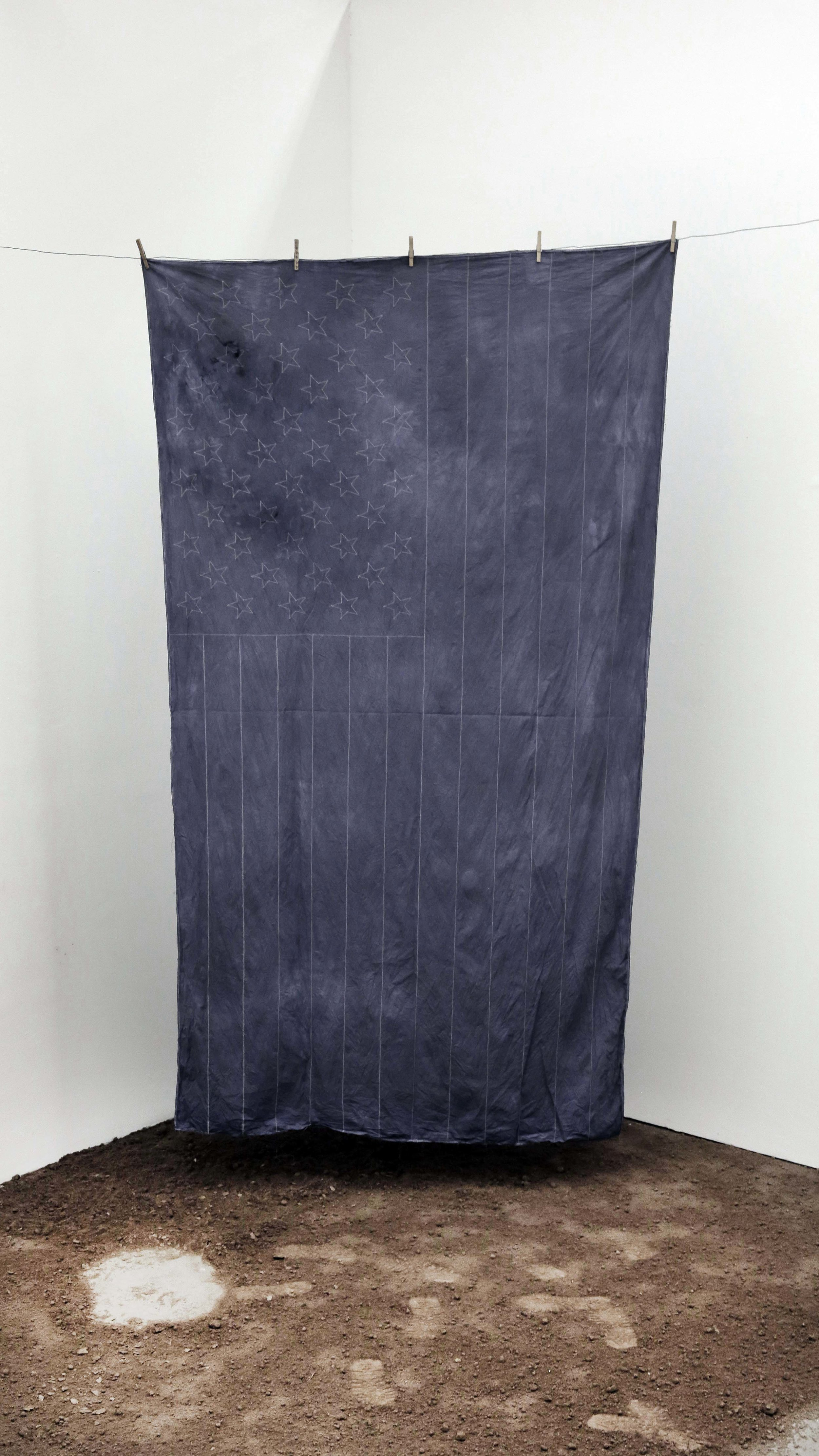 Ariel Jackson,  All I See Is Blue , 2017. Top layer soil from the Bronx, muslin fabric, blue dye, clothespins, wire polyester thread, 72 x 108 inches.