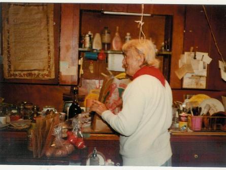 "AGNES BARON in her kitchen at the Meher Mount in 1978 before all the buildings were destroyed by the 1985 New Life"" Fire. (Margaret Magnus photo.)"