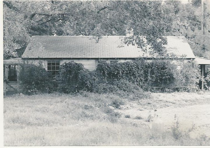 A SIDE VIEW OF THE FARMHOUSE and workshop looking from the main house. This is the site of the new Workshop completed in 2012. (Archive photo, possibly 1950s.)
