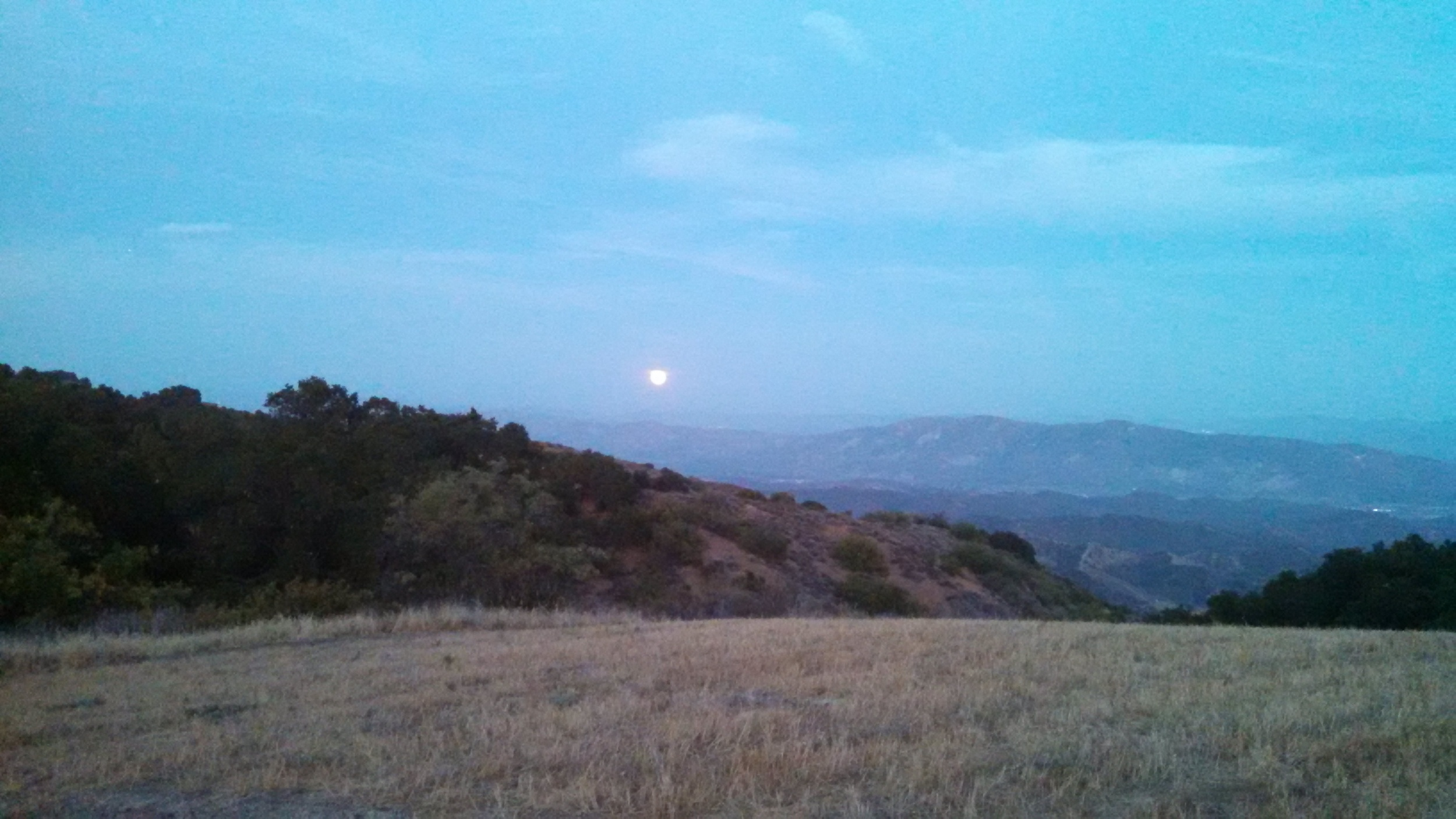 WATCHING THE FULL MOON RISE over Santa Paula and the Heritage Valley from Meher Mount. (Photo: Ron Holsey, July 12, 2014.)