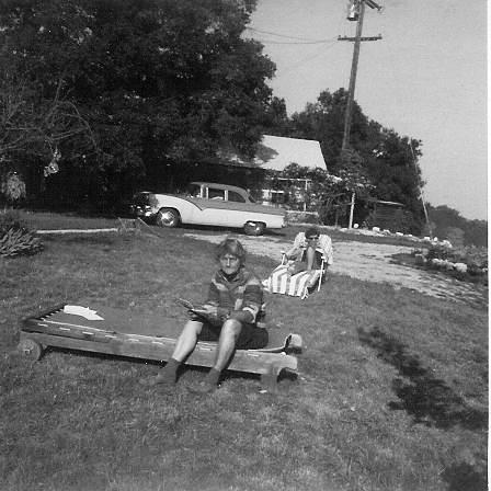 AGNES BARON (foreground) in a rare moment of relaxation. Unidentified woman in the background. They are in front of the farmhouse and garage. (Archive photo.)