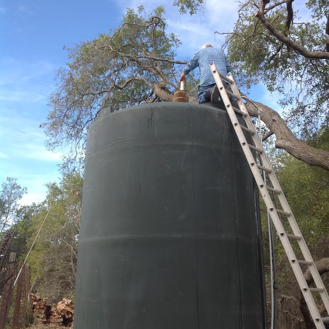 Manager/Caretaker Buzz Glasky working on the water tank. (Ginger Glasky photo, 2014.)