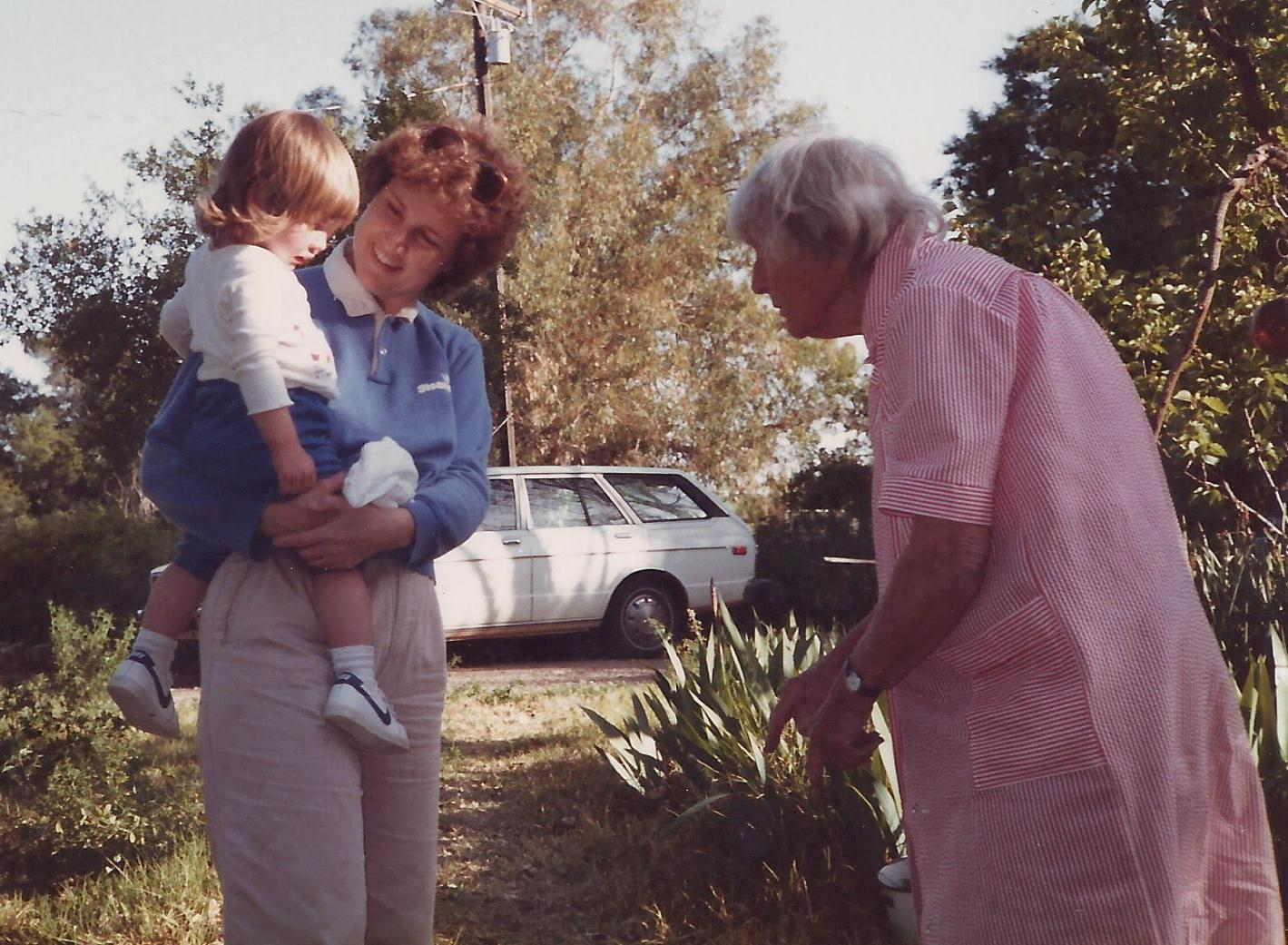 THE WHITE TOYOTA station wagon that Agnes Baron (right) got for herself is in the background. Visiting Agnes are (left) Margaret Magnus and her daughter Stephanie Ervin. (Sam Ervin photo, 1985.)
