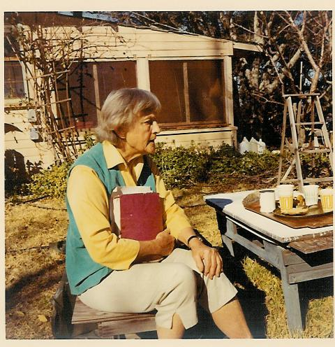 AGNES BARON holding a copy of  The Unstruck Music of Meher Baba  while visiting with guests at Meher Mount. (Sam Ervin photo, 1979.)