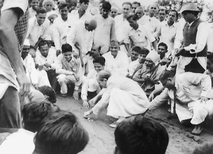 AVATAR MEHER BABA playing marbles with His disciples and followers.