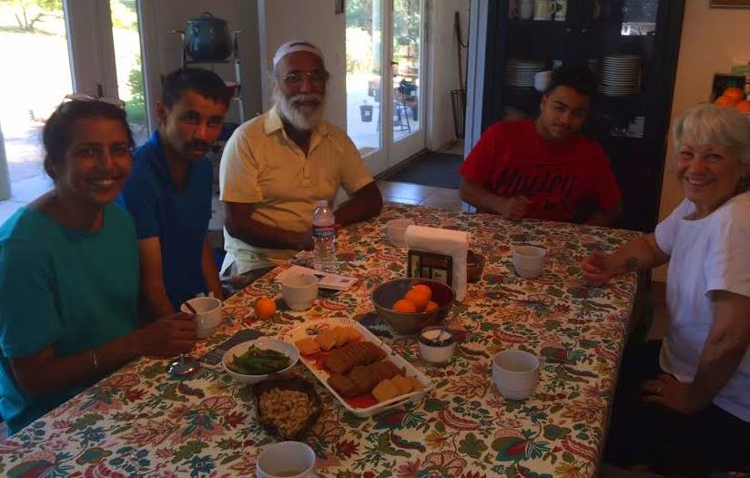 Deviner Chana, his sister Harjinder, and son Devin are sitting at the kitchen table with our grandson Austin Bernard and Ginger Glasky. (Photo: Buzz Glasky, April 2015)