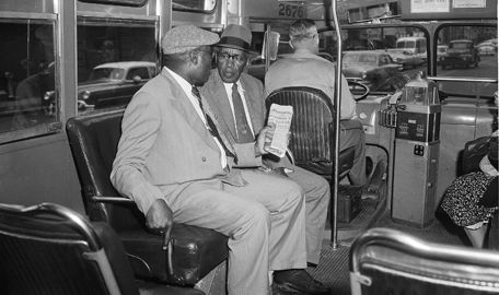 TWO BLACK MEN are shown here notably sitting behind the bus driver. The 13-month-long Montgomery Bus Boycott ended with the US Supreme Court's ruling that ended segregation on city buses. (Source: Finding Dulcinea) [5]