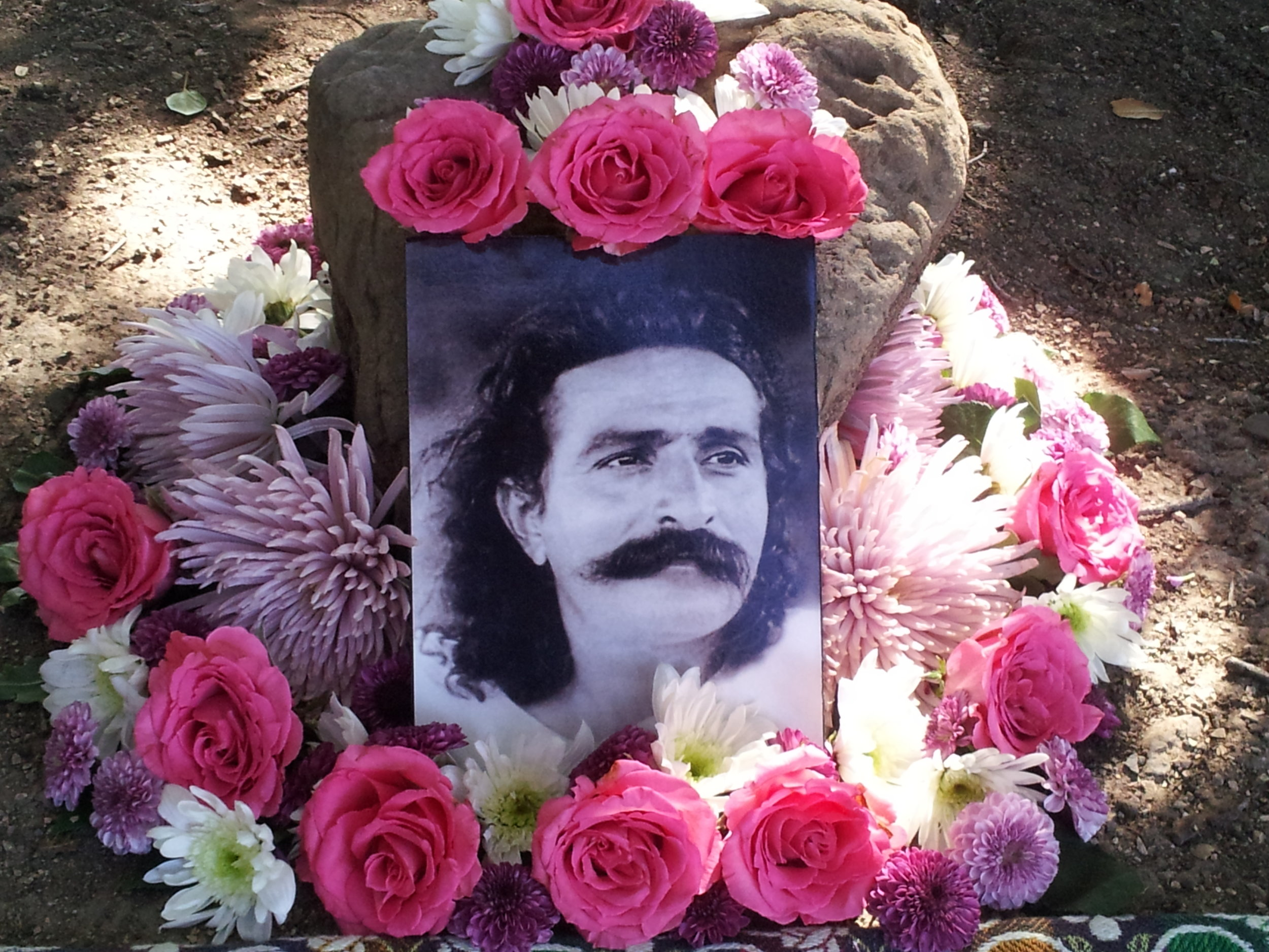 AVATAR MEHER BABA. Photo and flowers under Baba's Tree at Meher Mount,  Amartithi  2015. (Photo: Mendez-Montano)