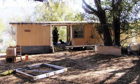 THE TRAILER brought onto the property after the 1985 New Life Fire by Board member Bing Heckman. Agnes Baron lived here until the Visitor Center/Caretaker Quarters was built in 1994. This photo is many years later in 2007 when the trailer was eventually demolished and removed from the property. (Photo: Ray Johnston, 2007)