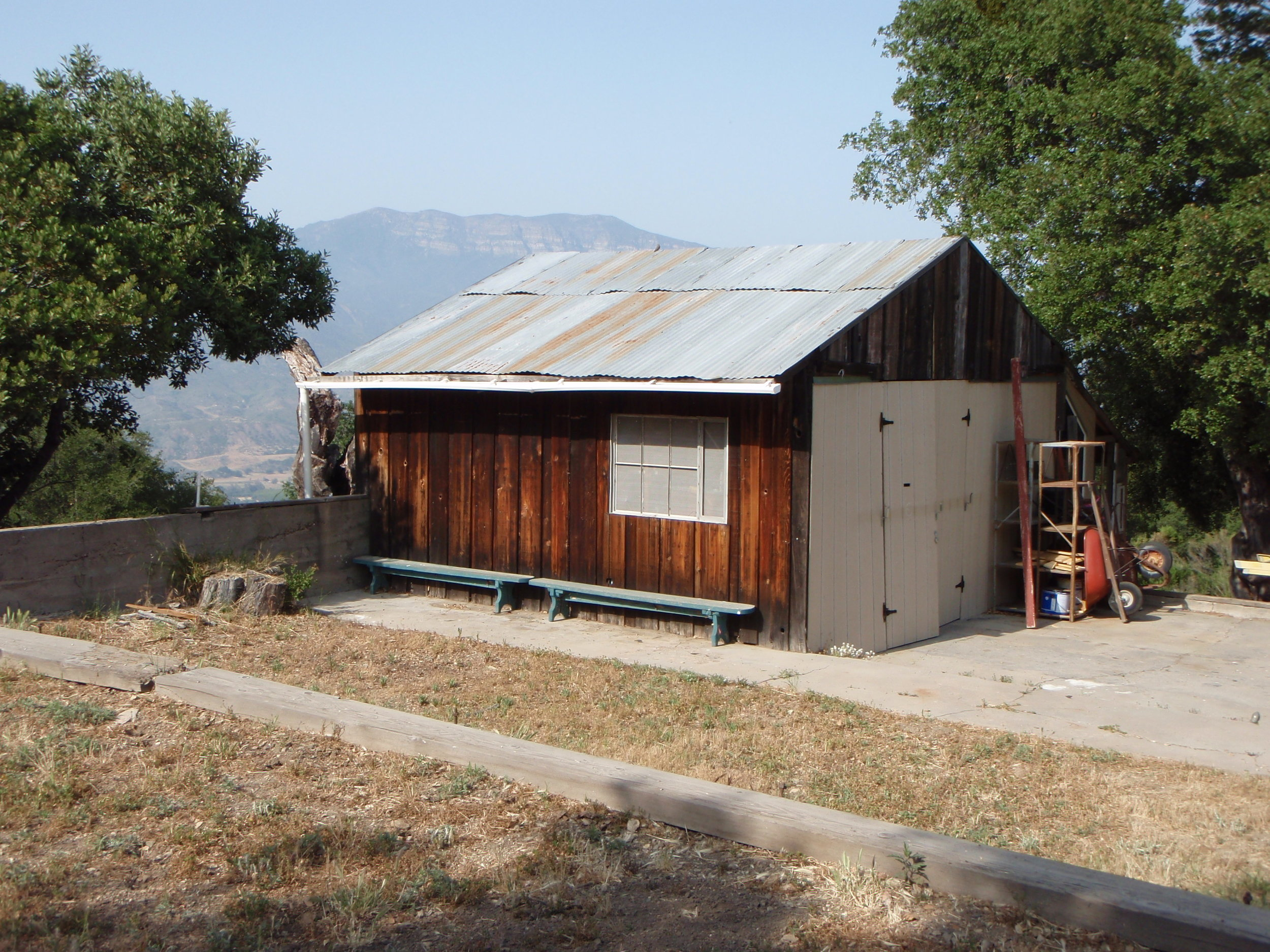 "THE ""TEMPORARY"" WORKSHOP built in 1985 with found materials. There were subsequent repairs and a door replacement in later years. (David McNeely photo, 2008.)"