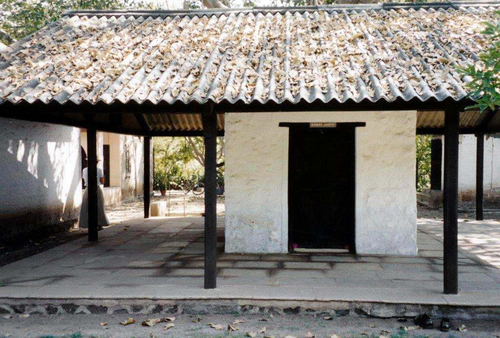 """AVATAR MEHER BABA came out of this  jhopdi (hut) in Meherabad, India, at 5:00 a.m. on Friday, July 10, 1925, marking the start of His silence. Asked how He would teach in silence, Meher Baba replied, """"I have come not to teach, but to awaken."""" (Sam Ervin photo.)"""