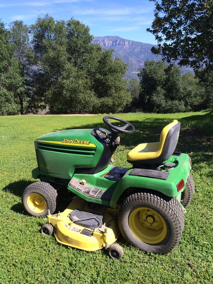 THE RIDE-ON MOWER, purchased in 2003, is still used by the Manager/Caretakers. (Photo: Buzz Glasky, 2015)