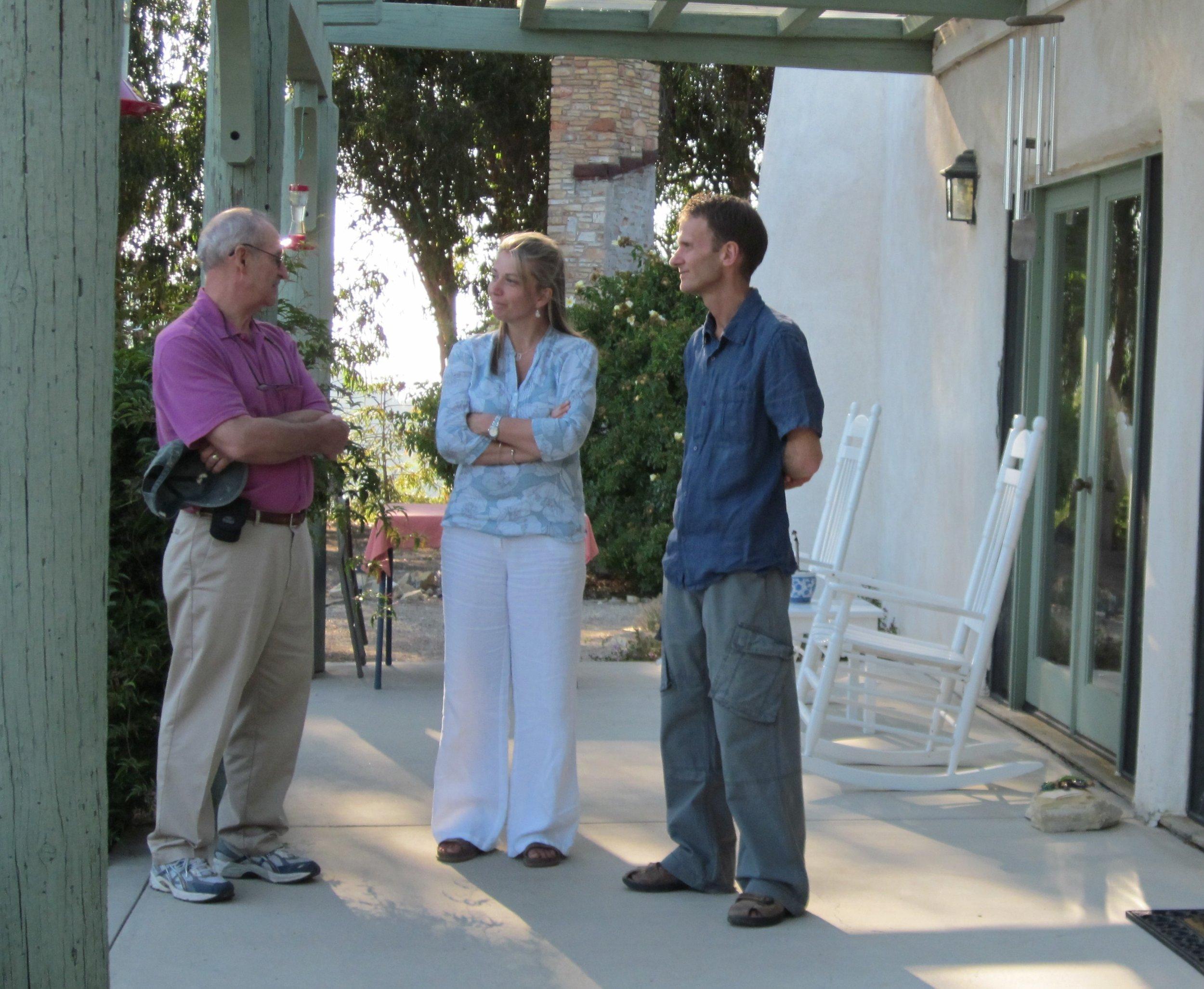SAM ERVIN, SAMANTHA BRIDGER & LESLIE BRIDGER on the porch of the Visitor Center/Caretaker Quarters at Meher Mount. (Photo: Wayne Myers, 2010)