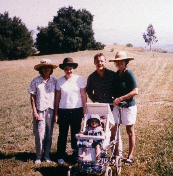 VISITORS Kacy Cook (Meherazad, India), Stephanie Ervin (Long Beach, CA) with Manager/Caretakers Billy and Pamela Goodrum and their daughter Rose. (Photo: Sam Ervin, 2000)