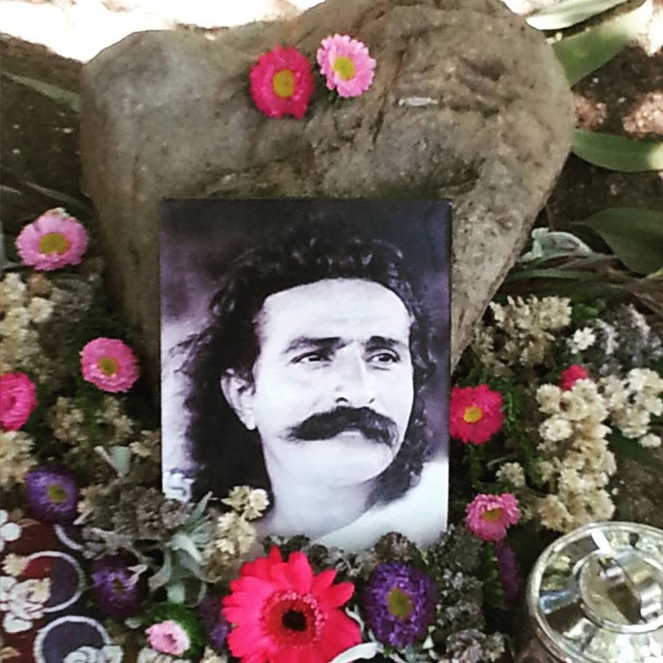 AVATAR MEHER BABA photo surrounded by flowers under Baba's Tree at Meher Mount. (Photo: Buzz Glasky, Anniversary Celebration 2015)