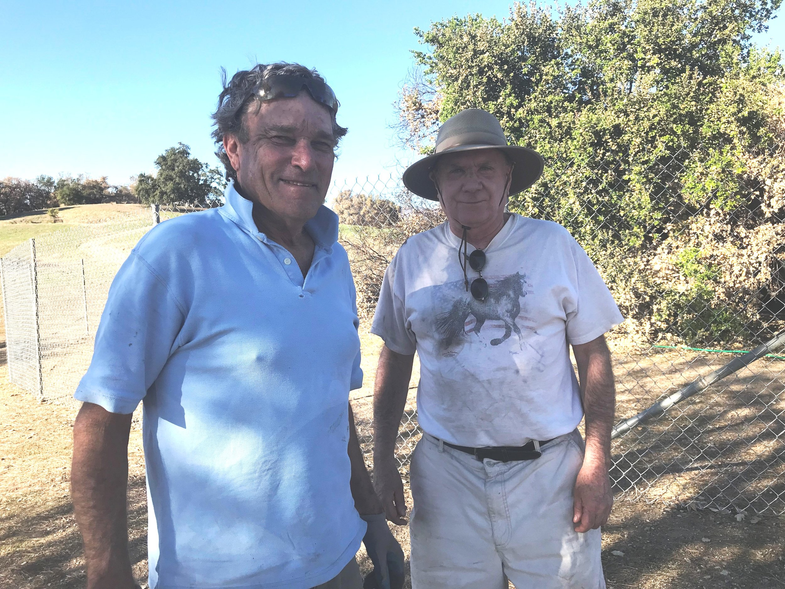 JIM AUSTER & JAMES WHITSON after the watering system for Baba's Tree is finished. (Photo: Sarah Larsen)