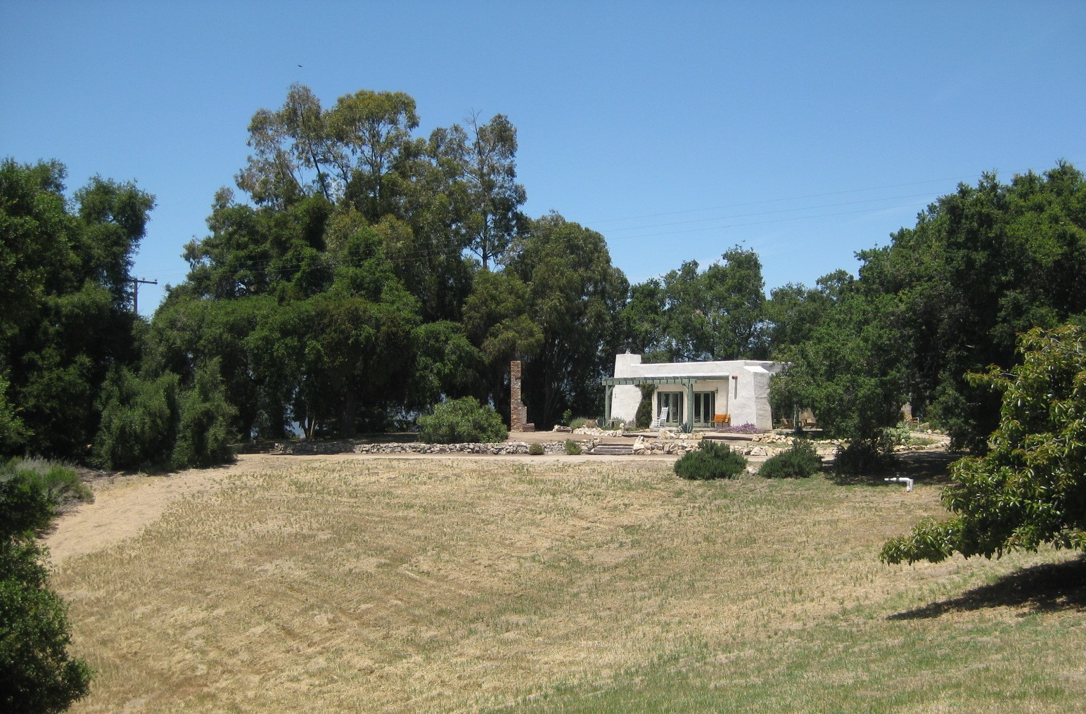 THE VISITOR CENTER and Caretaker Quarters with the eucalyptus stand in the background. (Photo: Leslie Bridger, June 2011)