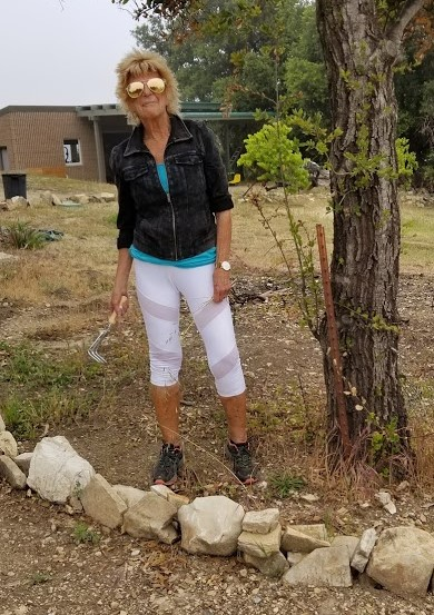 KATHY NAJAR came from Arizona with her partner Rudy Duran to volunteer for the two work days at Meher Mount. (Photo: Margaret Magnus, May 20, 2018)
