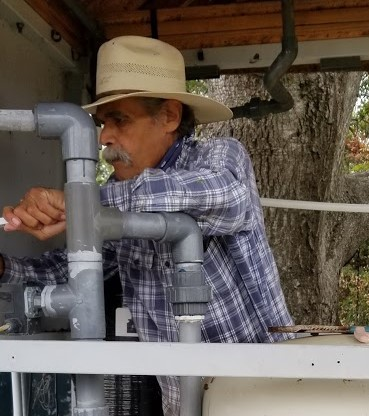 RUDY DURAN brought his water system expertise and changed the filters on the water treatment system. (Photo: Margaret Magnus, May 20, 2018)