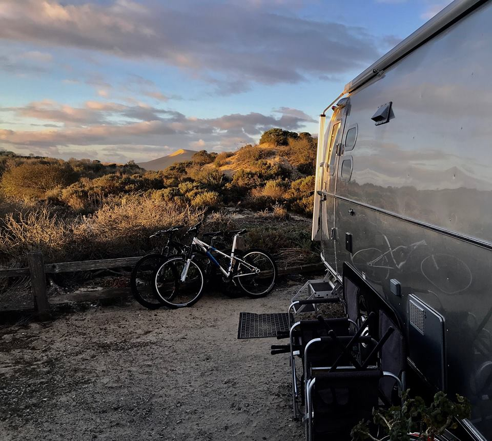 SUNRISE ON THE OCEANO DUNES. Buzz and Ginger Glasky, after evacuating from Meher Mount in December 2017, parked their Airsteam Trailer next to the Oceano Dunes in Oceano, CA. (Photo: Buzz Glasky, February 19, 2018)