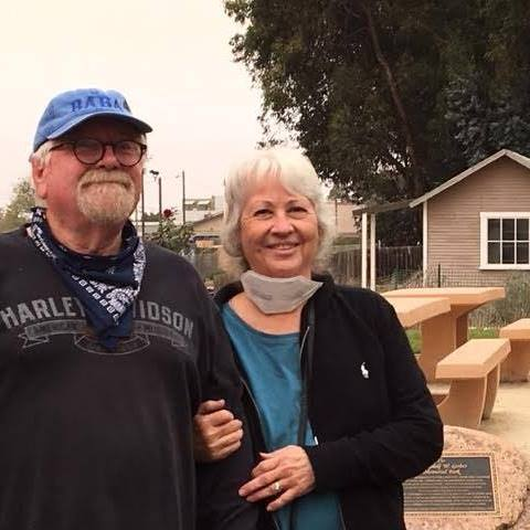 BUZZ AND GINGER GLAKSY with the restored house of Arthur Gavin in the background. Gavin was part of the Dunite group living in the dunes at Oceano when Avatar Meher Baba visited and spent the night in that house in 1934.