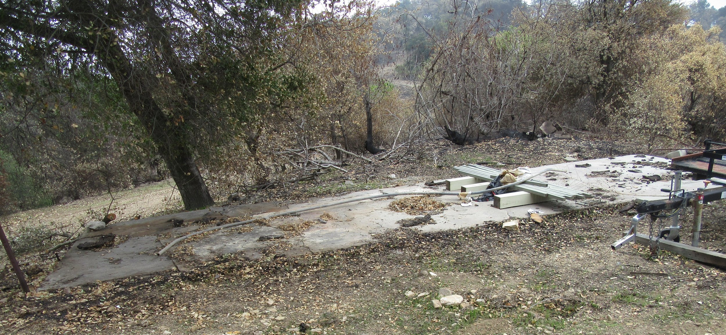 OLD CONCRETE FOUNDATION of a work shed at Meher Mount that burned to the ground in the 1985 New Life Fire. Volunteers cleared the area so this pad could be used to store milled wood from Baba's Tree. (Photo: Sam Ervin, January 19, 2018)