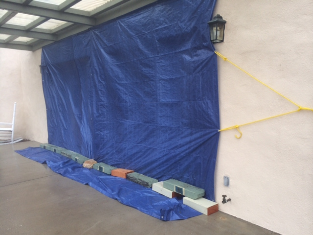 TARPS COVERING THE DOORS to the Visitor Center at Meher Mount to keep the wind from blowing in water during a heavy rainfall. (Photo: Buzz Glasky, 2014)