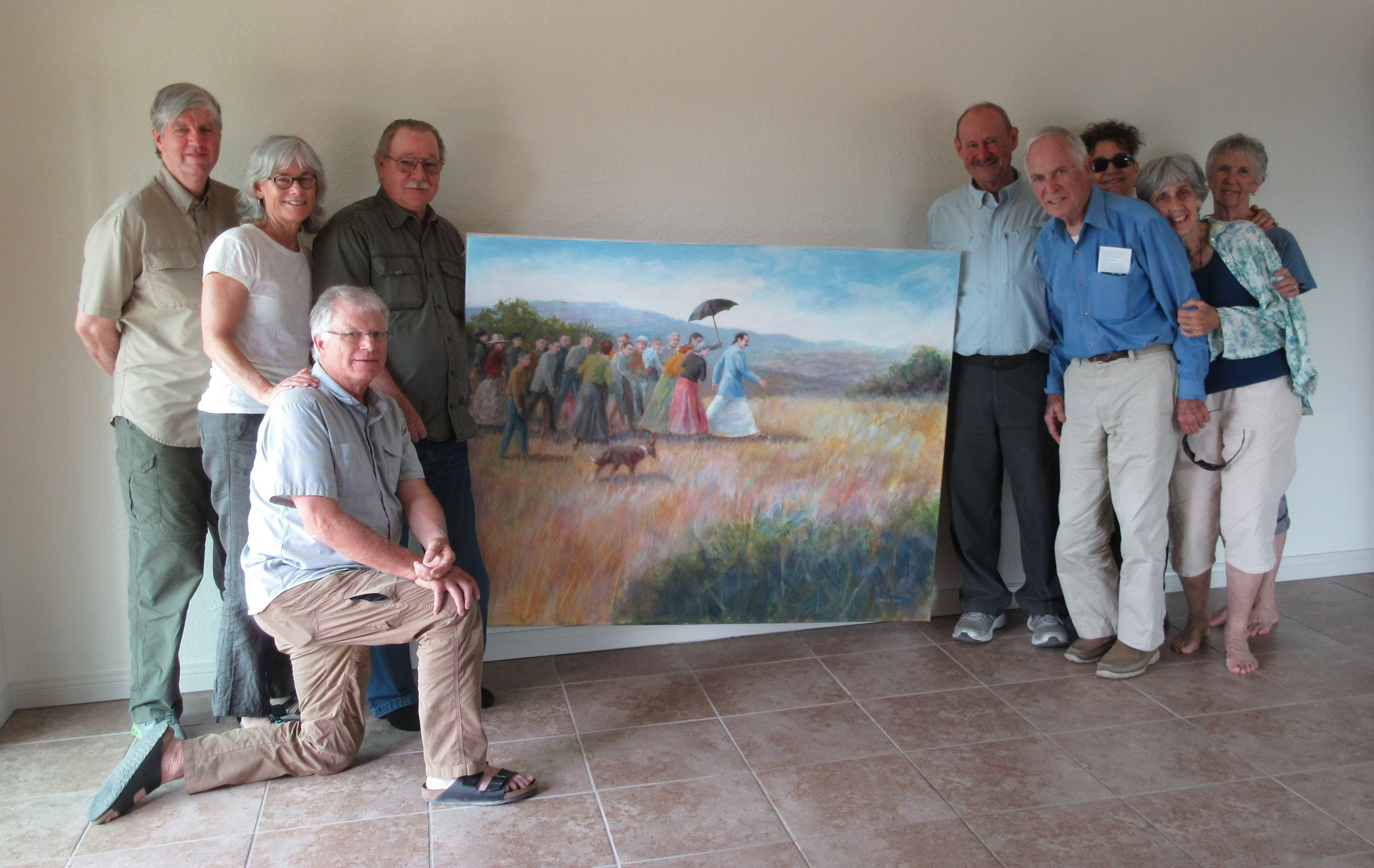 CELEBRATING THE ARRIVAL of Charles Mill's painting of Avatar Meher Baba and a special visit by Tom and Cathy Riley. (Left to right: Wayne Myers, Kristina Somma, Charles Mills, Robert Turnage (kneeling), Sam Ervin, Tom Riley, Marta Flores, Cathy Riley and Linda Mills. (Photo: Margaret Magnus, August 10, 2018)