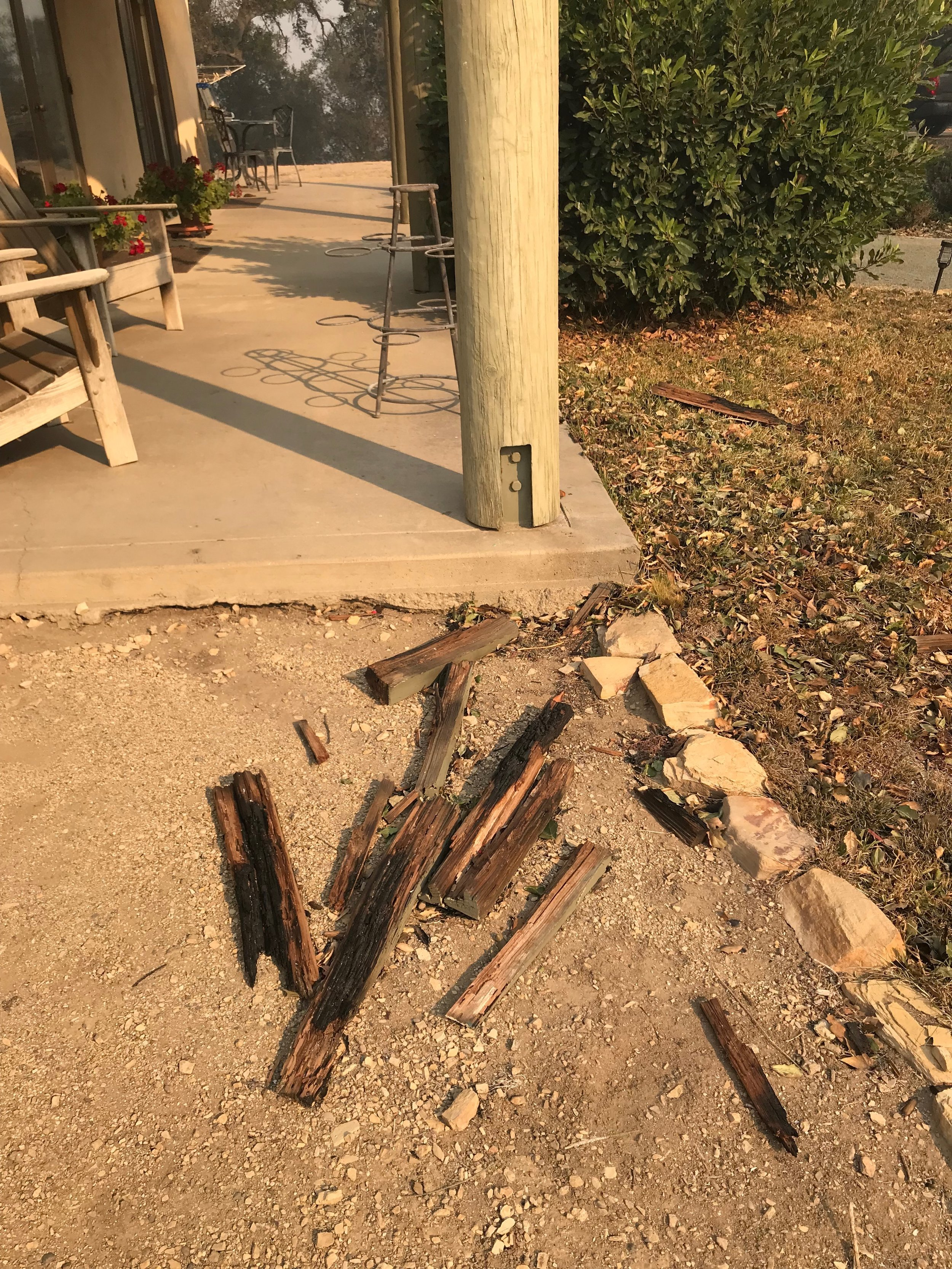 BURNED PIECES from the patio trellis of the Visitor Center/Caretaker Quarters at Meher Mount are a testament to how close the 2017 Thomas Fire came destroying the entire the building. (Photo: Buzz Glasky, December 2017)