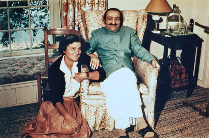 AVATAR MEHER BABA in the guesthouse at Meher Mount on August 2, 1956. Seated next to Him is co-founder and lifetime caretaker Agnes Baron. This building — with the exception of the fireplace — and all the other buildings on the property were destroyed in the 1985 New Life Fire.