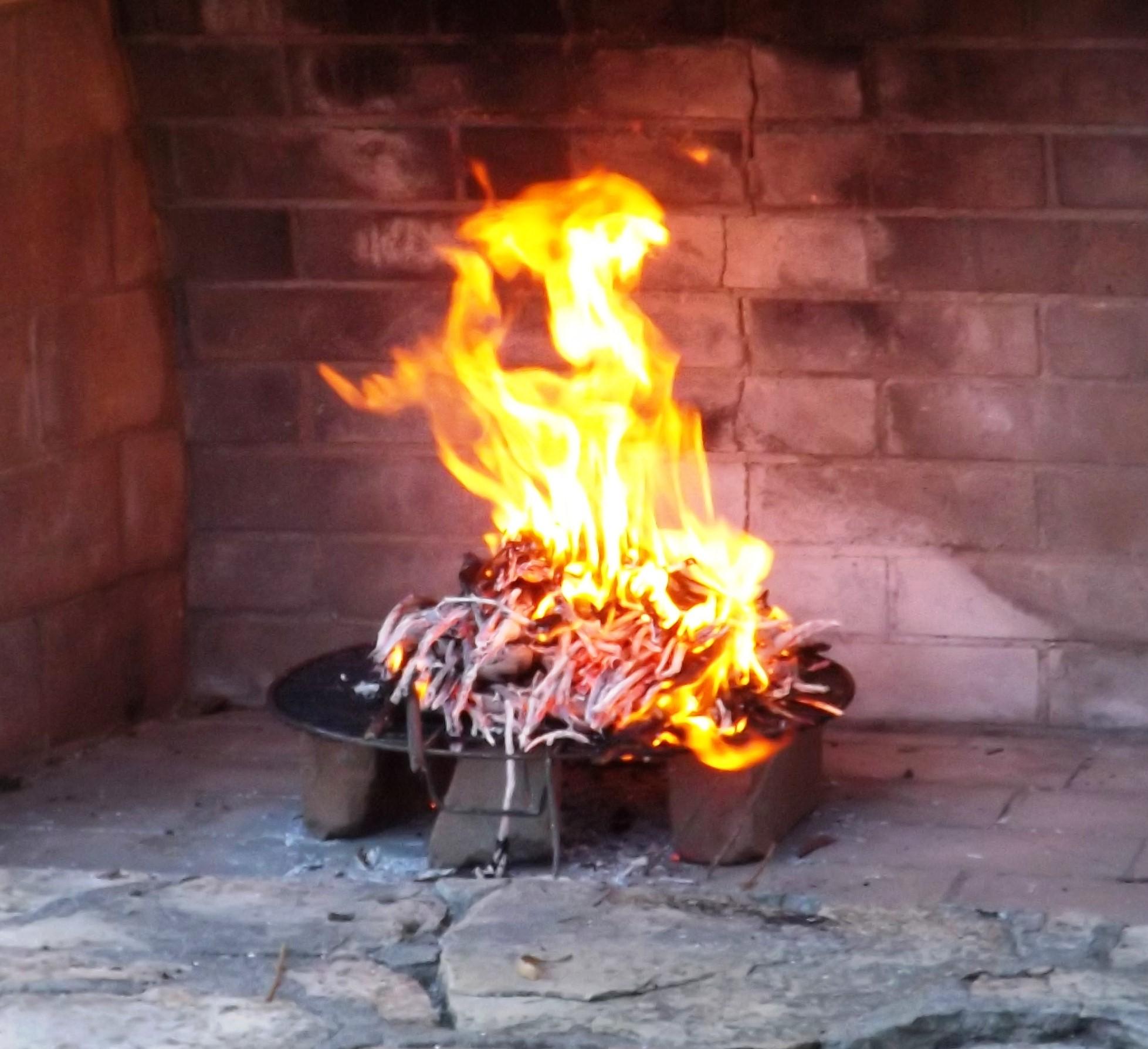 THE  DHUNI  - A SACRED FIRE. (Photo: Leslie Bridger, 2010)