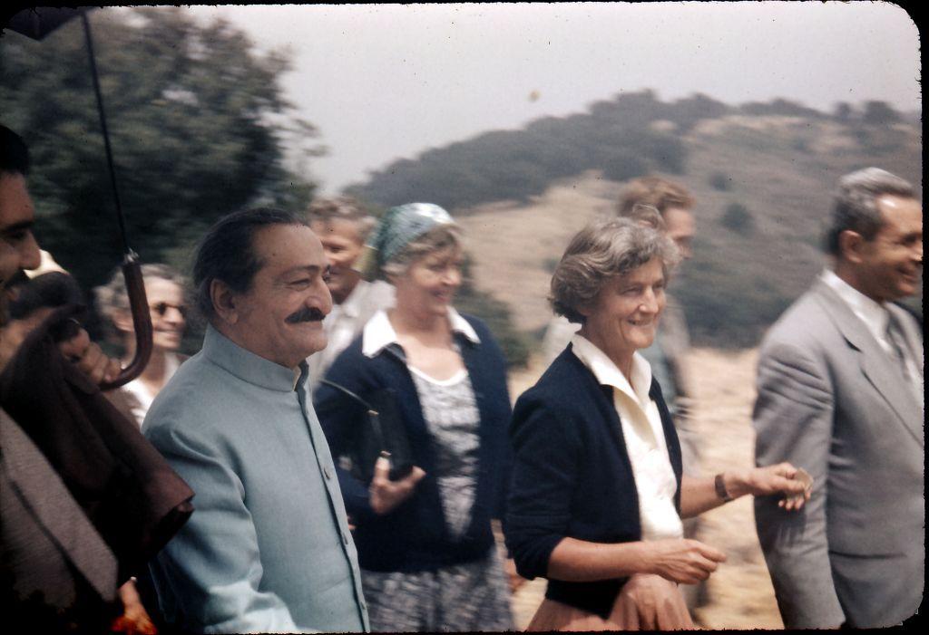 AVATAR MEHER BABA at Meher Mount on August 2, 1956. Walking next to Meher Baba is co-founder and lifetime caretaker of Meher Mount, Agnes Baron and close Indian disciple, Meherjee Karkaria. (Photo: Drawin Shaw (c) Meher Nazar Publications)