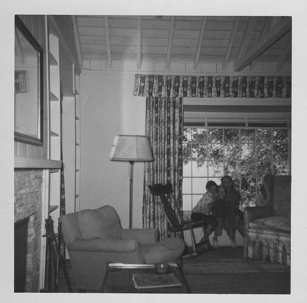 THE 'BABAROOM' in the guest house at Meher Mount. Joan Dimpfl Harland sent these photos taken by her father Lud Dimpfl in November 1956, just months after Meher Baba's 1956 visit. The fireplace to the left of the photo, now known as Baba's Fireplace, is the only remaining piece of this special room where Meher Baba gave  darshan  to His followers. All the buildings were destroyed in the October 1985 New Life Fire. The wing-back chair to the right in front of the window was where Meher Baba sat, and it, too, burned in the 1985 fire. The area that once contained this room is now called the Darshan Courtyard. The children are Joan Dimpfl Harland, Claudia Dimpfl O'Hanrahan, and Diane Dimpfl Cobb (also known as BBB or 3B as nicknamed by Meher Baba).