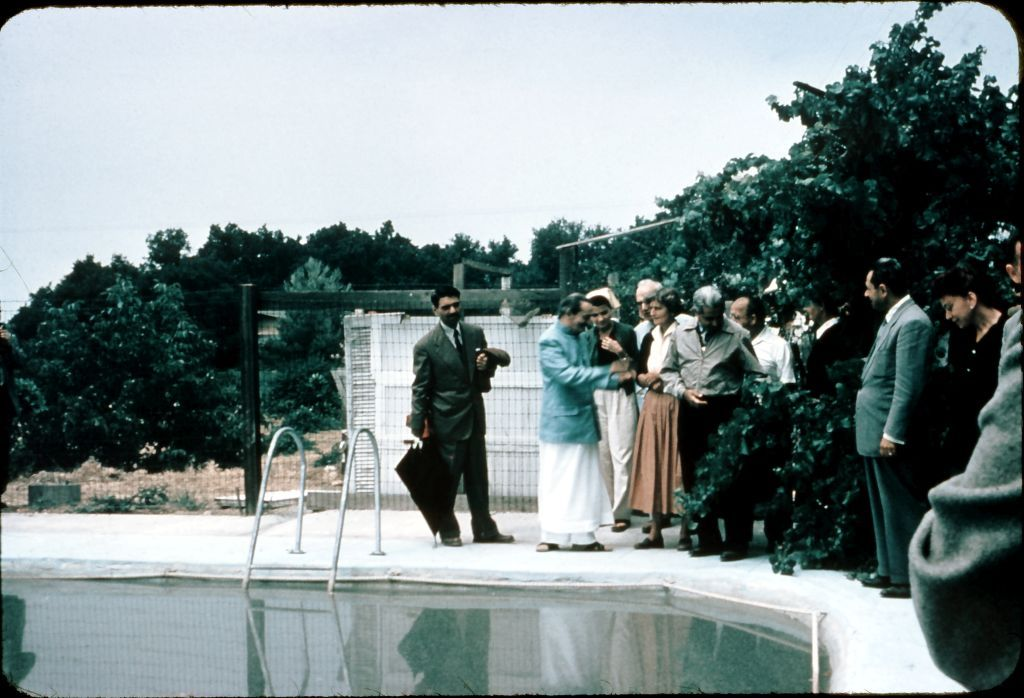 AT THE SWIMMING POOL which is now a water reservoir at Meher Mount. (Left to right): Eruch Jessawala, Avatar Meher Baba, Bili Eaton (light scarf), Meher Mount co-founder and lifetime caretaker Agnes Baron (orange skirt), Adi K. Irani and Meherjee Karkaria. (Photo: Darwin Shaw, ©Meher Nazar Publications)