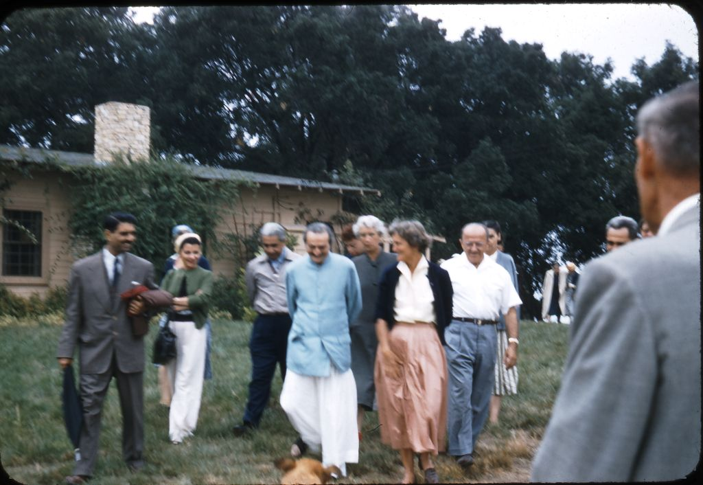 AT MEHER MOUNT on August 2, 1956. (Left to right): Eruch Jessawala, Bili Eaton, Adi K. Irani, Avatar Meher Baba, Enid Corfe, Agnes Baron, Fred Winterfeldt, Meherjee Karkaria, and Frank Hendrick. (Photo: Darwin Shaw, ©Meher Nazar Publications)