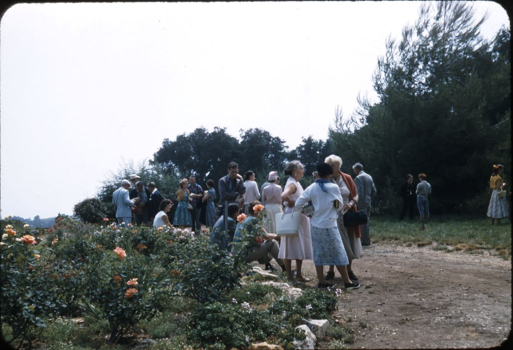 AT DAY'S END on August 2, 1956, visiting Meher Mount with Avatar Meher Baba. Margaret Craske is in the foreground carrying the white purse. She is talking with Kitty Davy and an unidentified woman. (Photo: Darwin Shaw, ©Meher Nazar Publications)  To help identify anyone in the photograph, please contact Meher Mount.