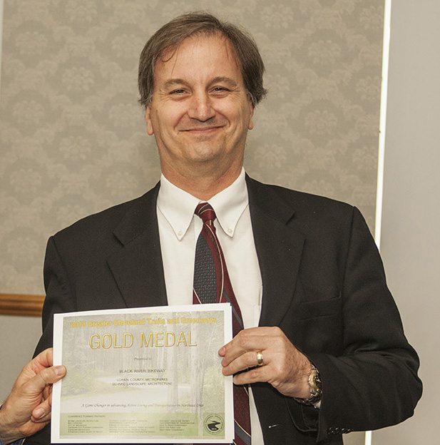 Jim Ziemnik, Lorain County Metro Parks, receives Gold Award for the Black River Bikeway