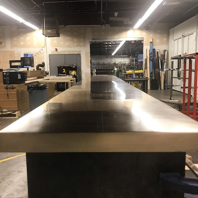 Bronze countertop in progress....picking up a nice reflection in the shop  @corefitri #bronze #metalfab #architecturalmetalwork #countertops